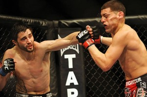 Condit-punches-Diaz-UFC-143-photo